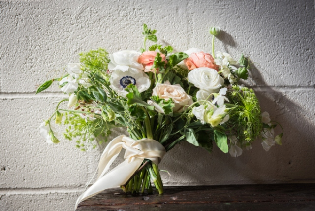 The wedding flowers were done in white, peach and blush with lots of greenery
