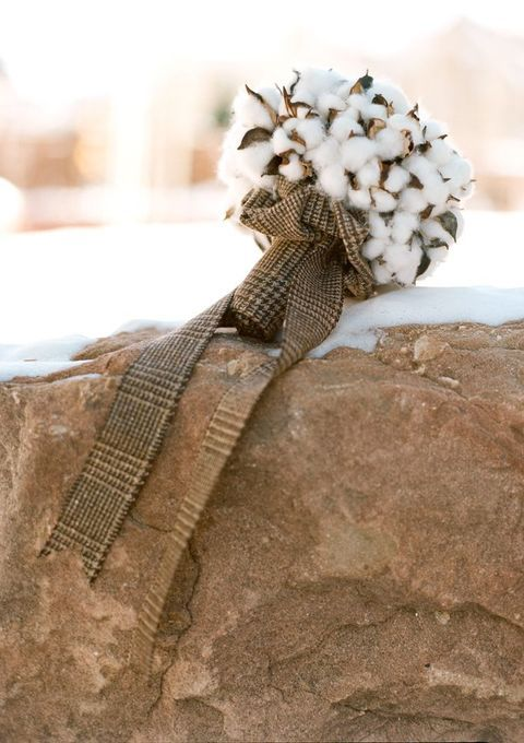a cotton wedding bouquet in a tweed wrap and tweed ribbons for a winter wedding