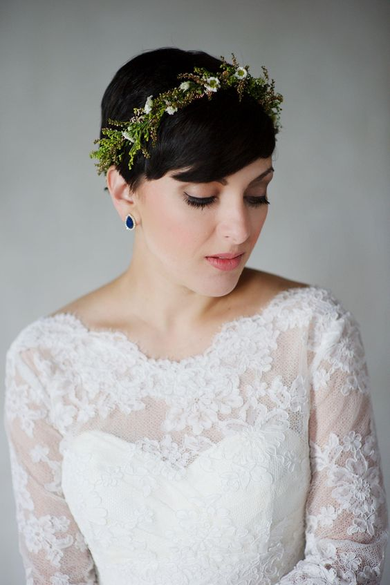 a pixie hairstyle with a fresh floral and greenery headband plus sapphire earrings for a statement