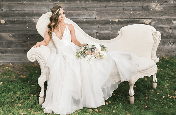 a plunging neckline wedding dress with a layered skirt and a double necklace to highlight the neckline