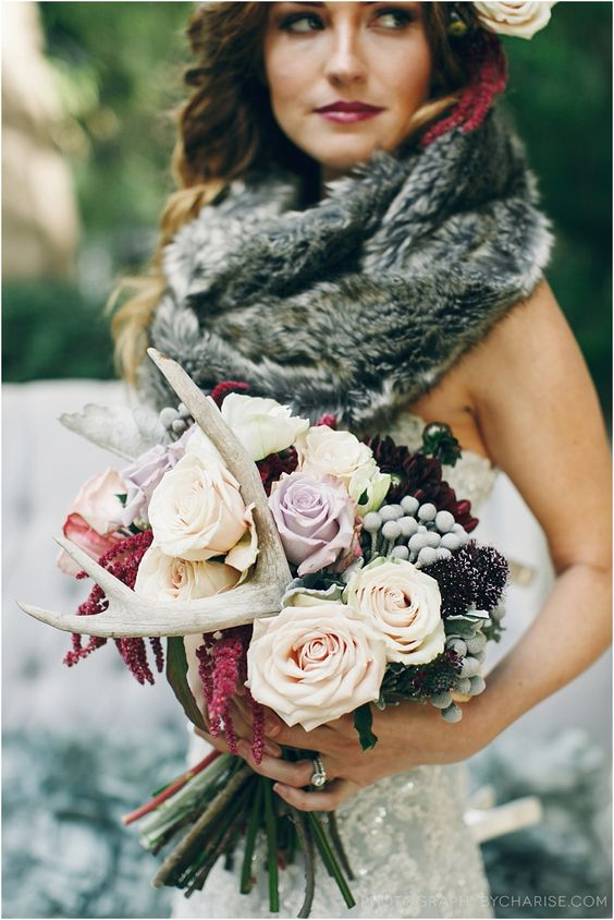 a woodland fall wedding bouquet with dark and pastel blooms, antlers and amaranthus
