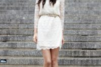 04 an ivory lace wedding dress with long sleeves and a leather belt on the waist, statement earrings and nude shoes