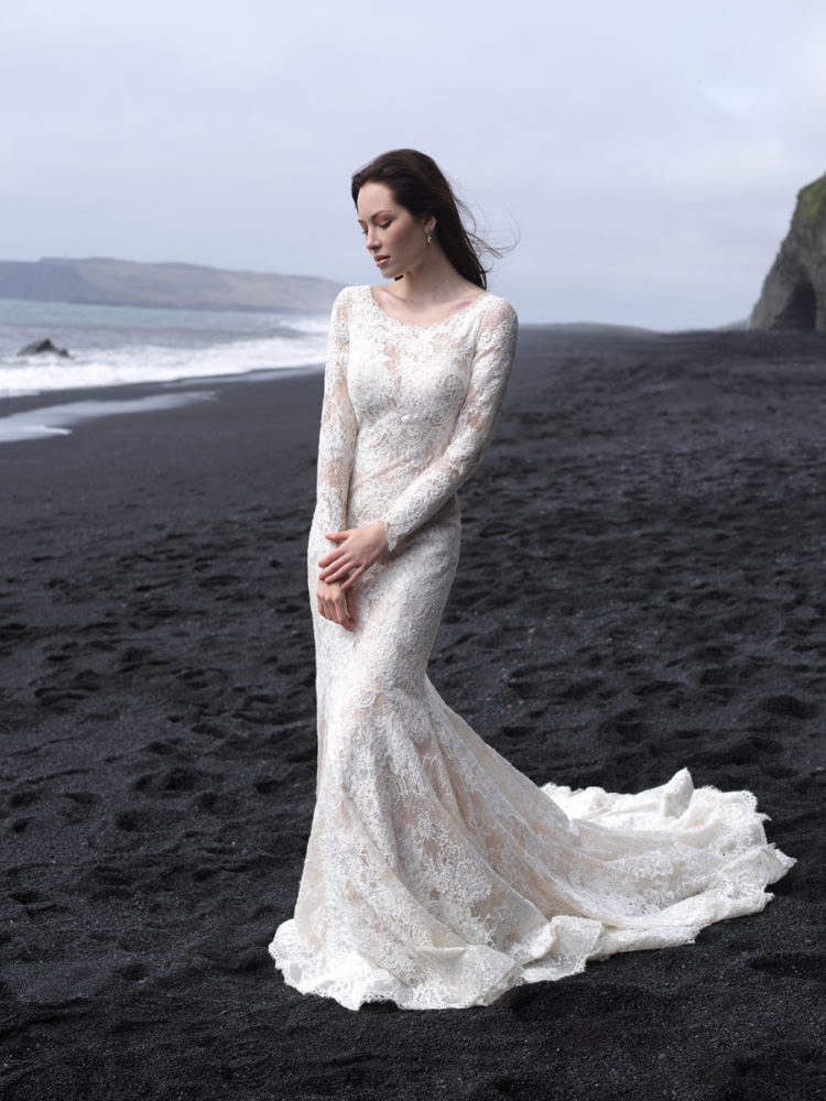 A lace scoop neckline wedding dress with a small train and long sleeves looks very romantic