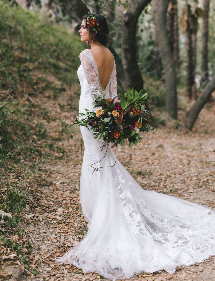 An open back and a train made the dress amazing, and a floral crown matching the bouquet was a moody flal one