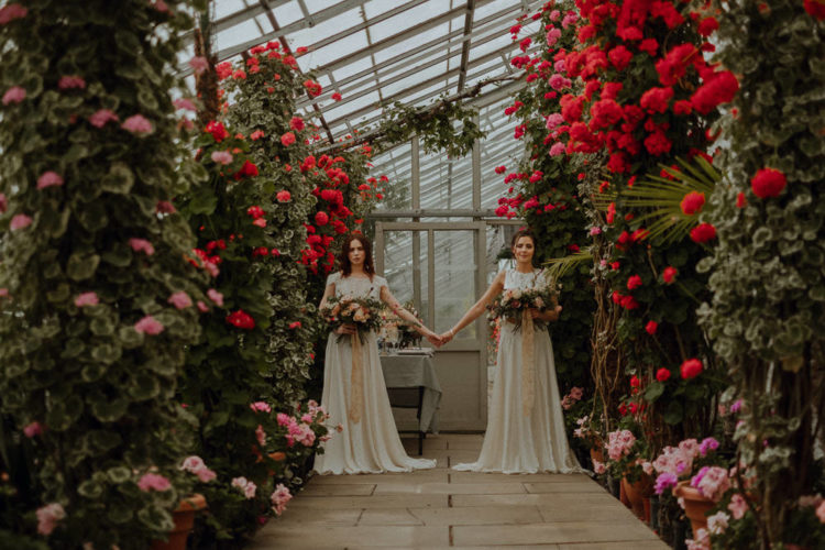 Inside the greenhouse you can see lots of bold blooms and greenery, which became a great backdrop for the wedidng