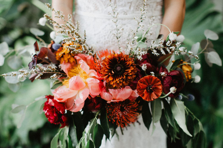The bridal bouquet was a bold one, done in burgundy, orange, burnt orange and red