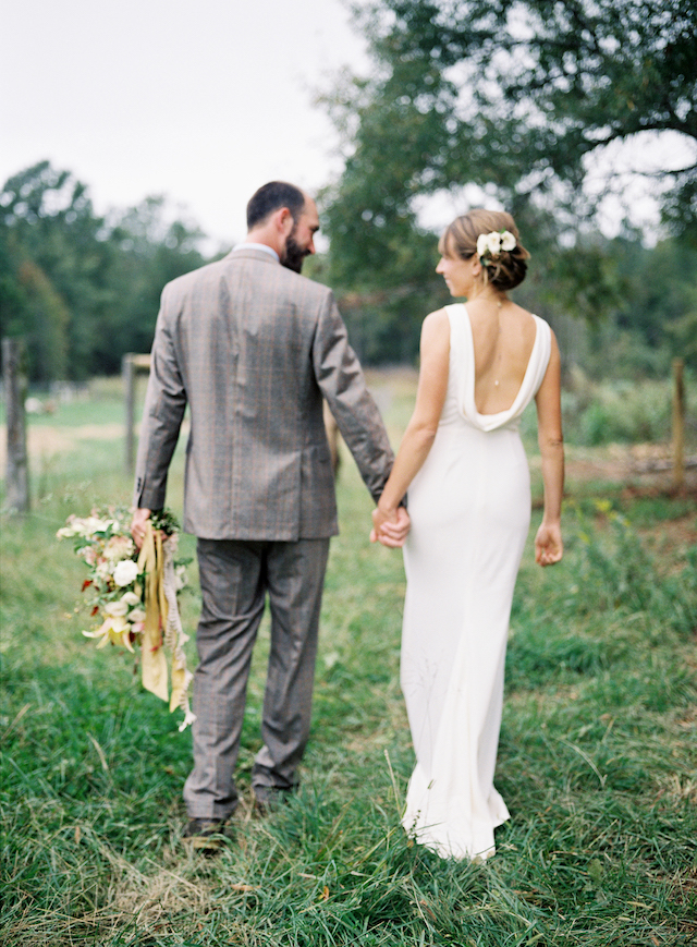 The bride was rocking a romantic updo and a back necklace