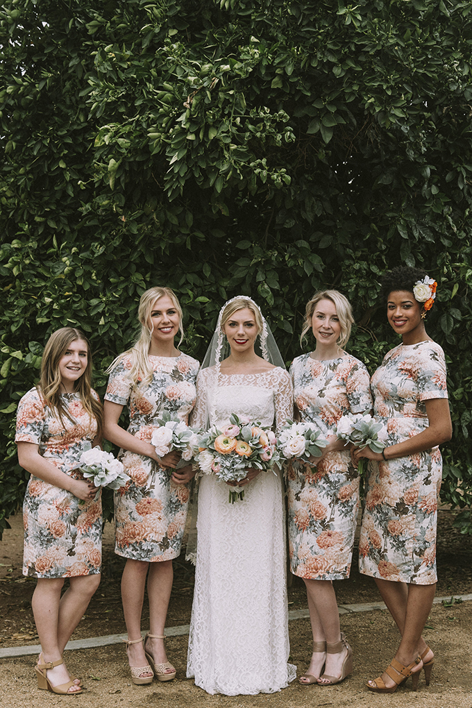 The bridesmaids were rocking floral print peachy dresses with short sleeves from ASOS