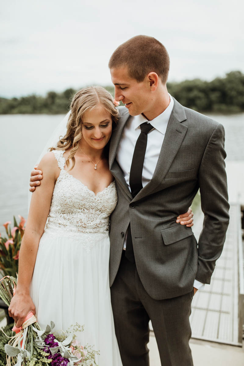 picture of the groom was wearing a grey wedding suit with