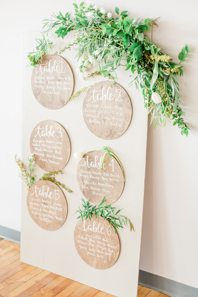 The seating chart was done with cork pinboards and fresh greenery
