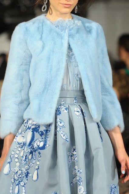 an icy blue faux fur coat with half sleeves will be a gorgeous idea for a winter bride