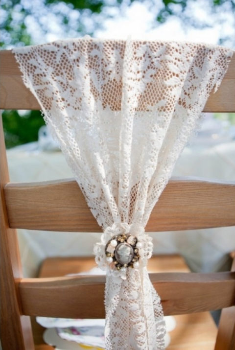 some lace and a vintage brooch is a simple idea that will suit lots of themes, from backyard to vintage