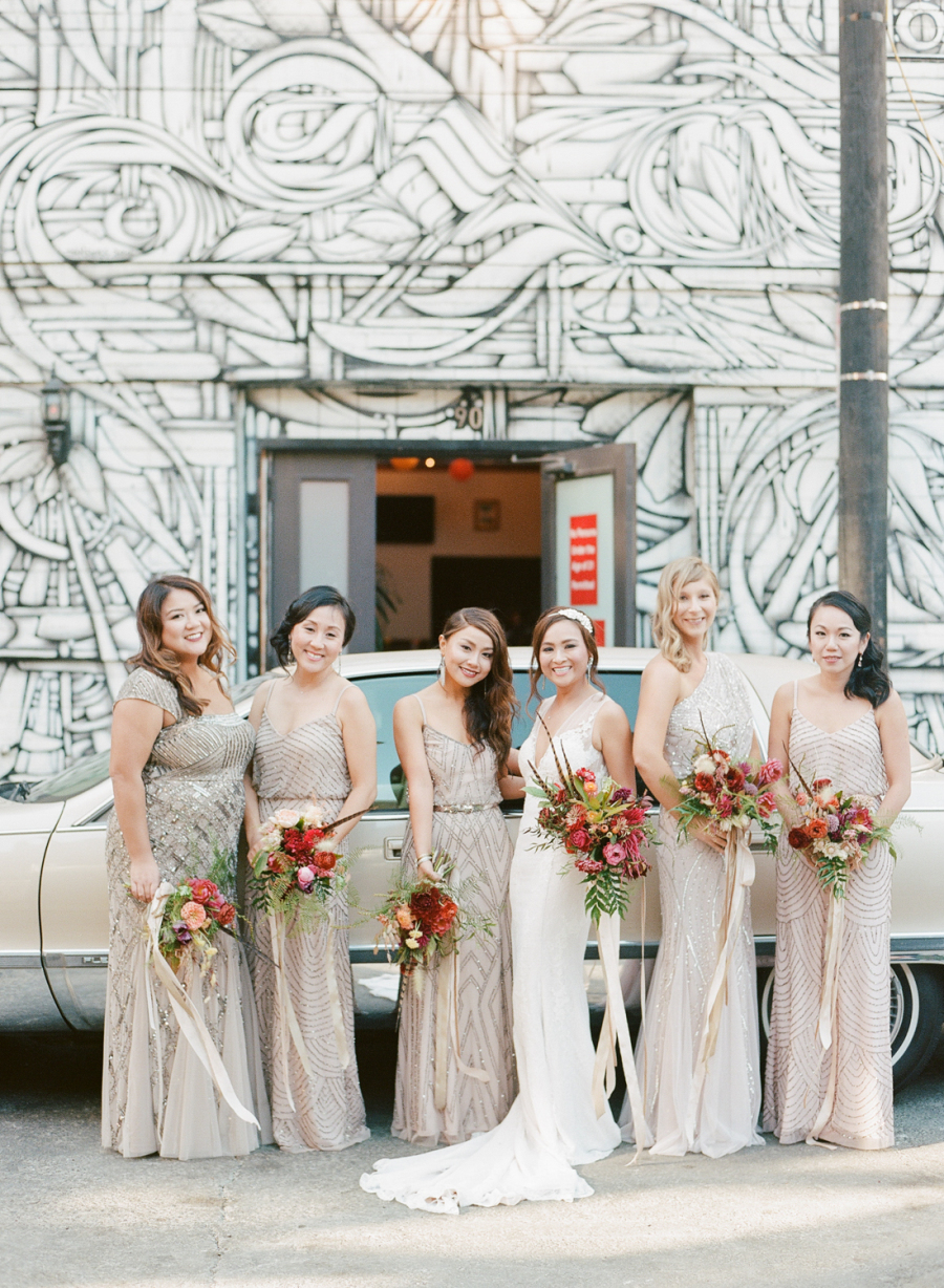 The bridesmaids were wearing mismatching art deco gowns of different neutral shades