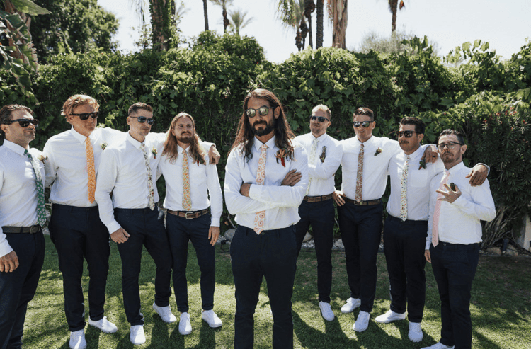 The groomsmen were wearing the same as the groom and different colorful printed ties