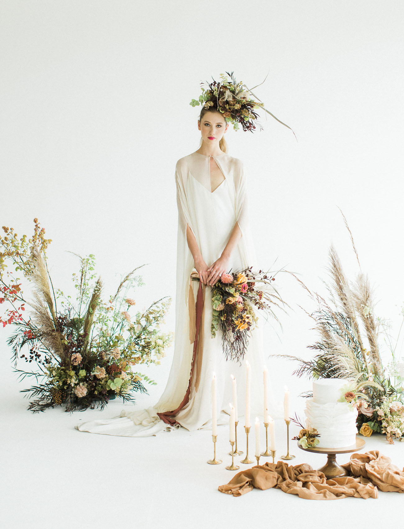 The third wedding gown was a modern V neckline one with an ethereal cape over it for an airy feel