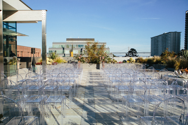 The wedding ceremony space was done with acrylic chairs, which made it modern and cool