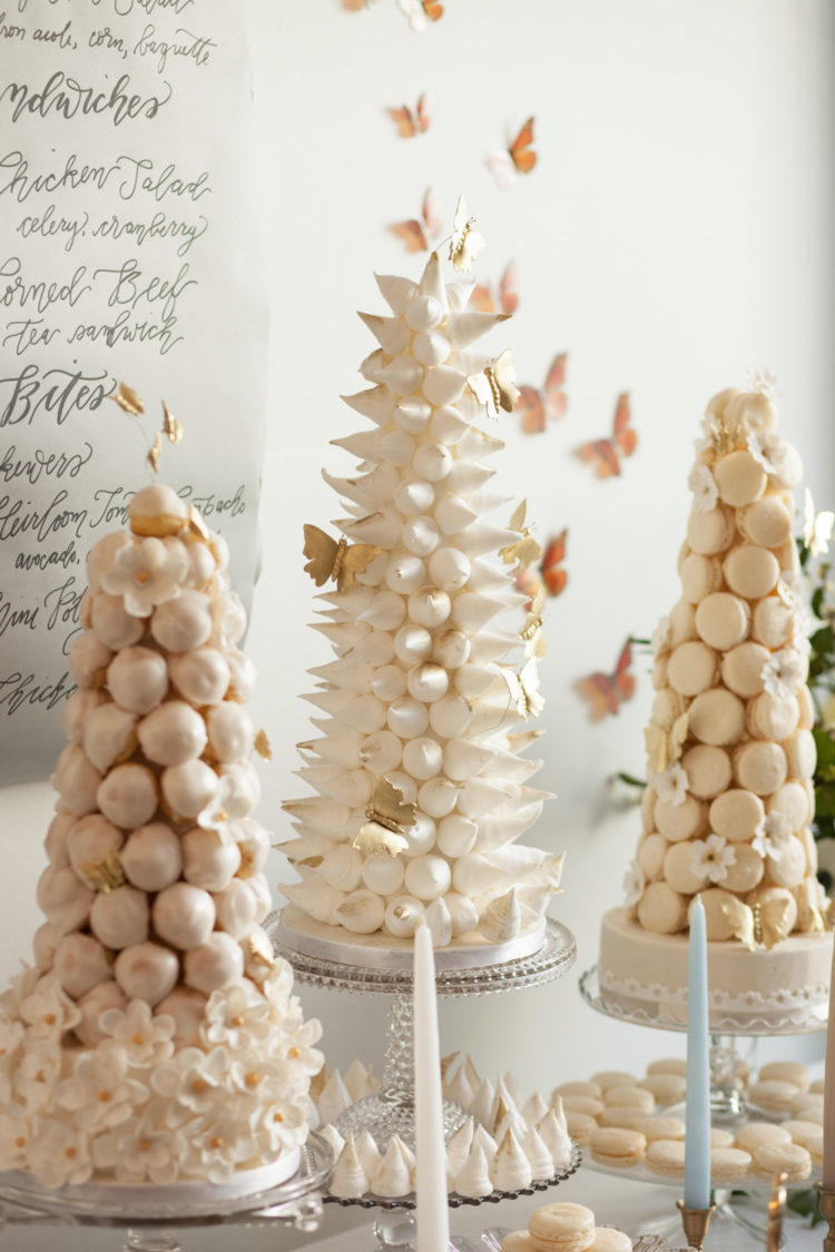 You can see a macaron, croquembouche and meringue tower with butterflies all around