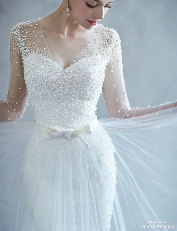 Picture Of a gorgeous pearl wedding dress with an illusion neckline ...