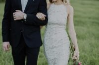 06 a sheath boho lace wedding dress with a halter neckline and an accented waist looks very modern and chic