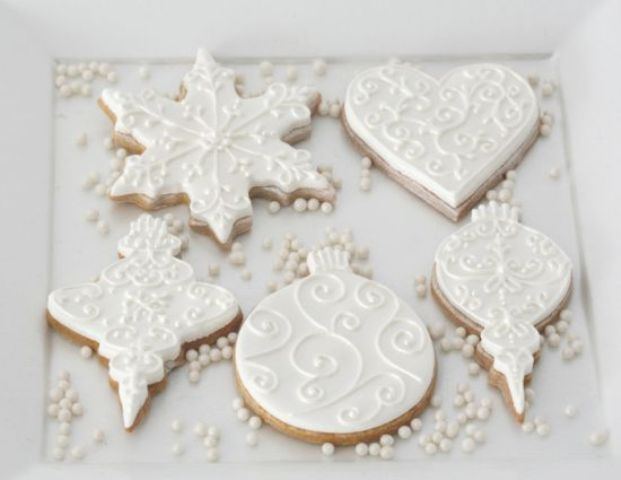 gorgeous Christmas ornament frosted cookies are an elegant and tasty solution for any winter wedding