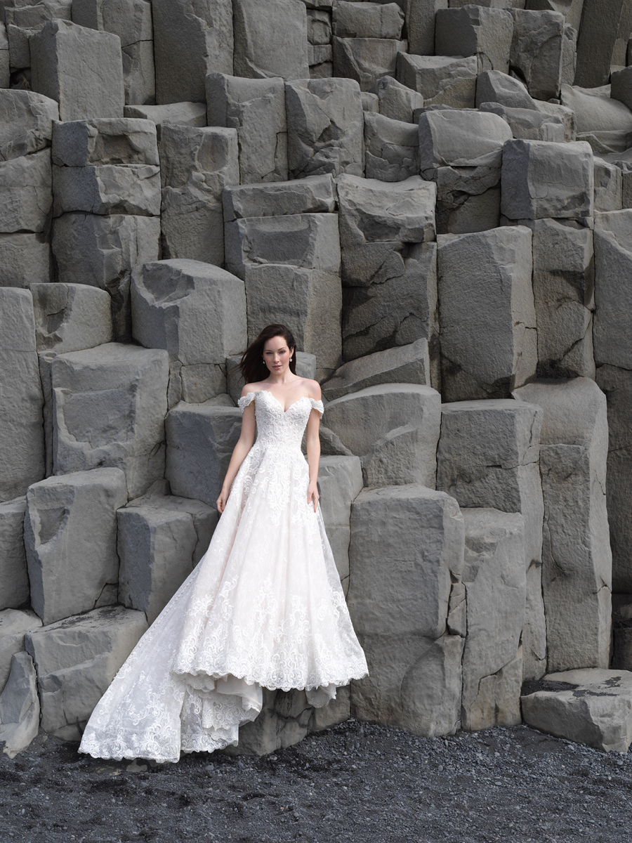A gorgeous off the shoulder lace wedding dress with a small train looks very romantic