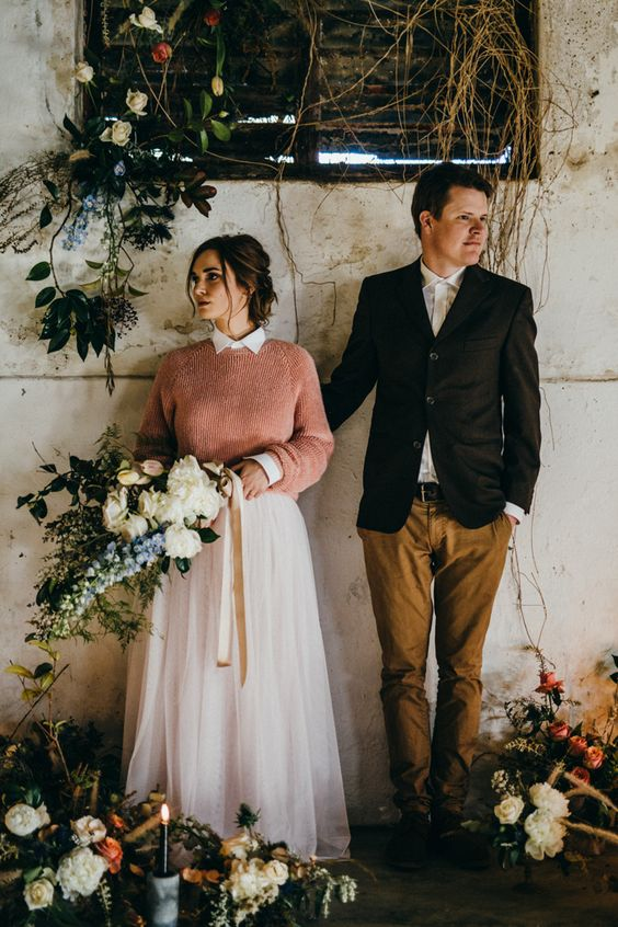 Picture of a bride rocking a pink sweater over her wedding for Sweater over wedding dress