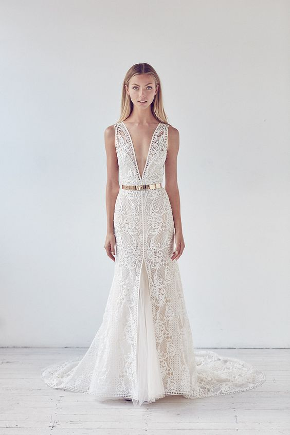 a chic wide strap plunging neckline wedding dress of boho lace, a front slit and a metallic belt