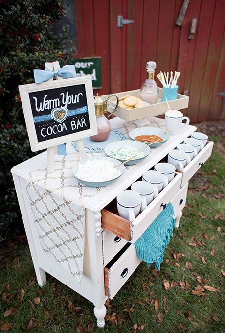 a hot cocoa bar is another great idea, make it using a vintage sideboard you have at hand and a cute chalkboard sign
