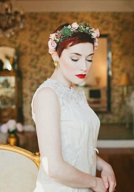 a pixie haircut with a fresh crown of pink roses, succulents and greenery for a romantic and sexy bride