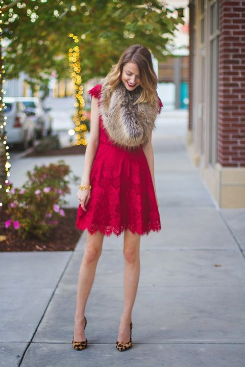 a red lace mini dress with a faux fur shawl and leopard print shoes for a Christmas wedding