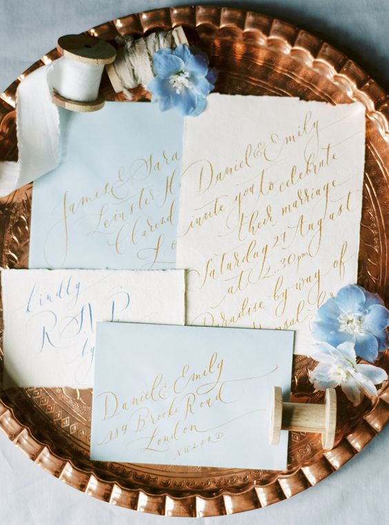 pastel blue wedding invitations with gold calligraphy for a blue spring wedding