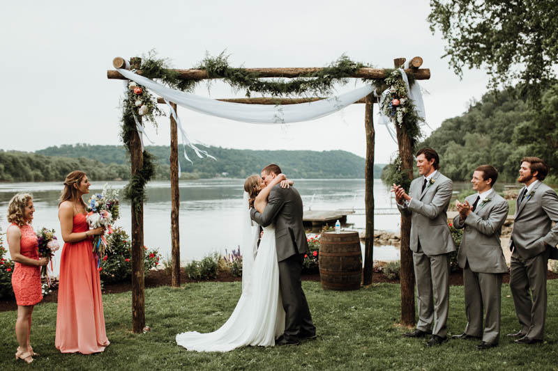 The wedding arch was done of wood, greenery, flowy fabric and blooms, the space looked peaceful and quiet