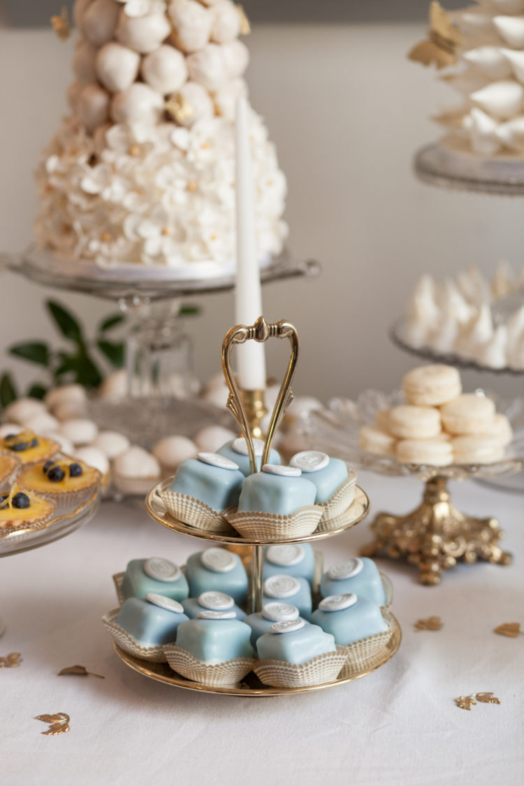 These are Cinderella blue petit fours with a fondant wax seal