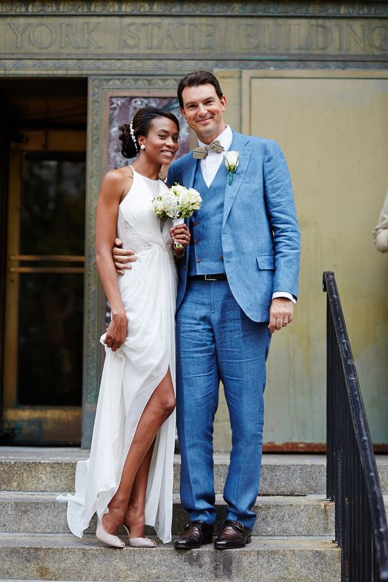 a chic draped halter neckline wedding dress with a slit, lace inserts and white peep toe shoes