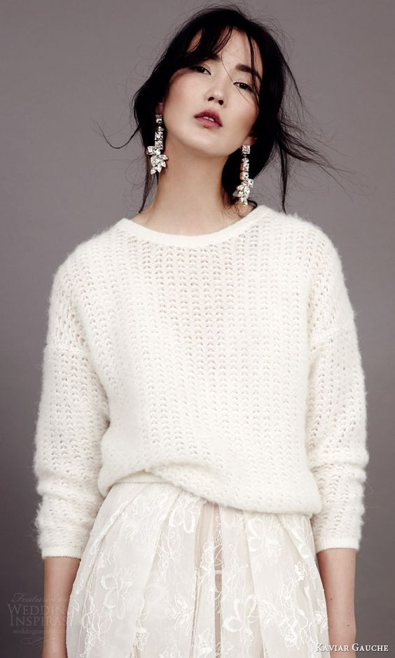 a cozy white sweater with angora over your wedding dress will be a gorgeous coverup