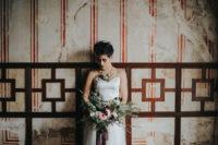 08 a modern daring bride with a textural pixie haircut, a bold lip and fresh floral accessories