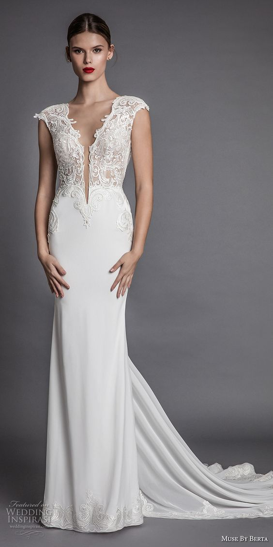 a stunning cap sleeve plunging neckline wedding dress with a textural bodice and sleek sheath skirt