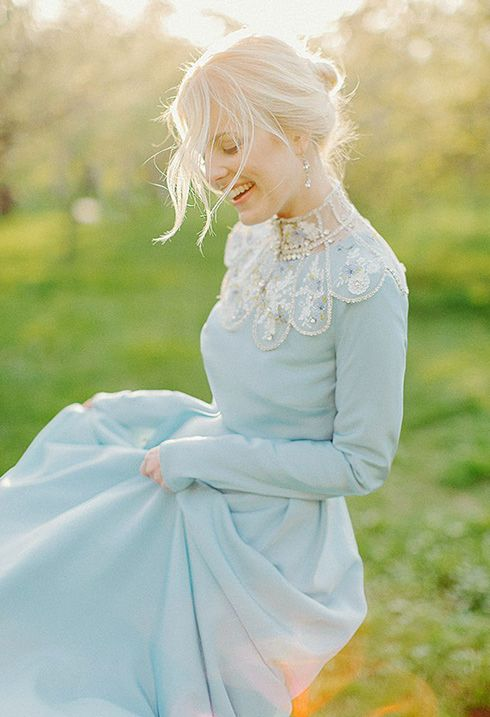 a unique ice blue wedding dress with embroidery and embellishements and long sleeves