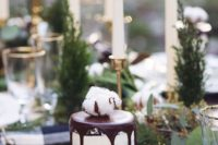 08 individual semi frosted wedding cake with chocolate dripping and cotton on top