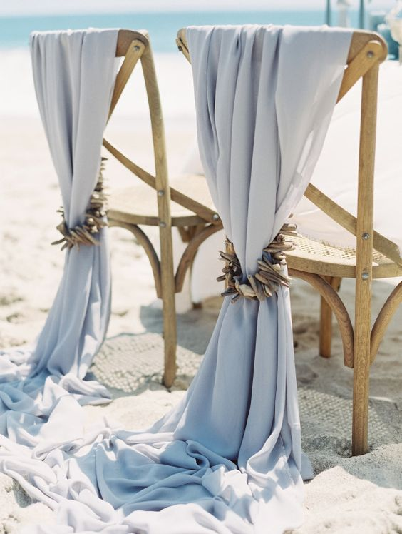 pale blue fabric with shell and driftwood pieces for a coastal wedding