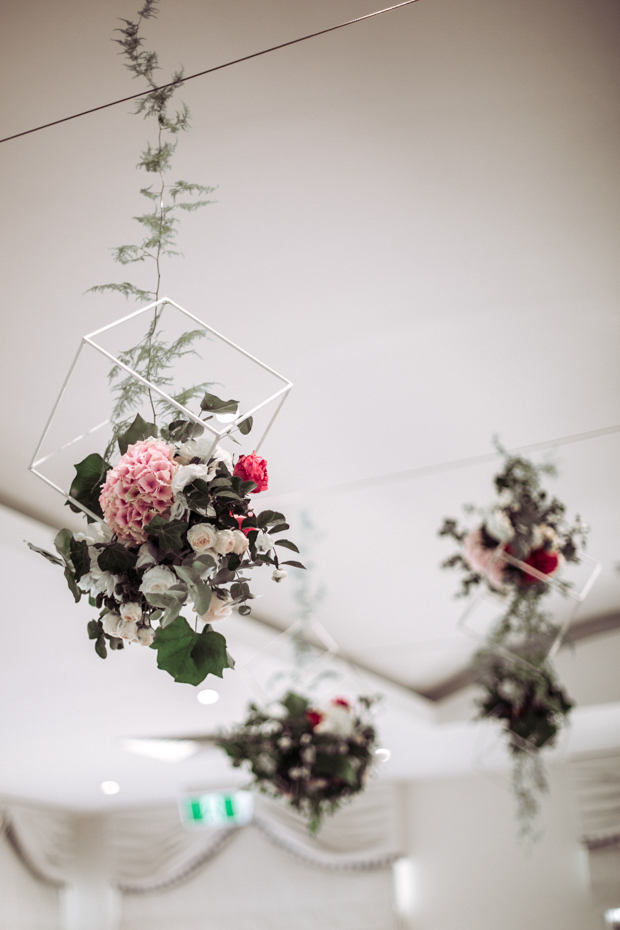 Geometric floral and greenery chandeliers were a chic and trendy touch to the space