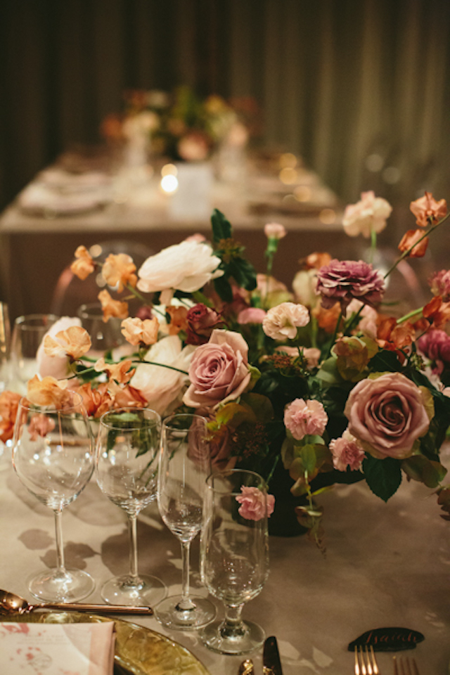 Gorgeous refined florals in pink and orange were used for the wedding venue