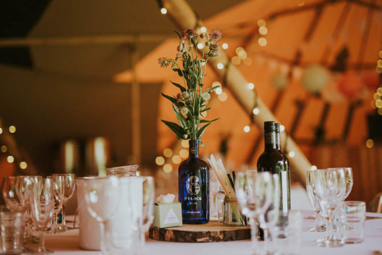 The wedding decor was pretty simple, with simple blooms in different bottles that were gathered by the brids