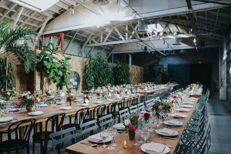 The wedding reception was done with lots of greenery and an industrial feel, and the blooms were bold and colorful