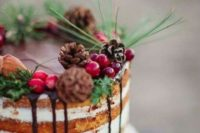 09 a naked wedding cake with chocolate drip, pinecones, cranberries, evergreens and nuts is ideal for a woodland wedding