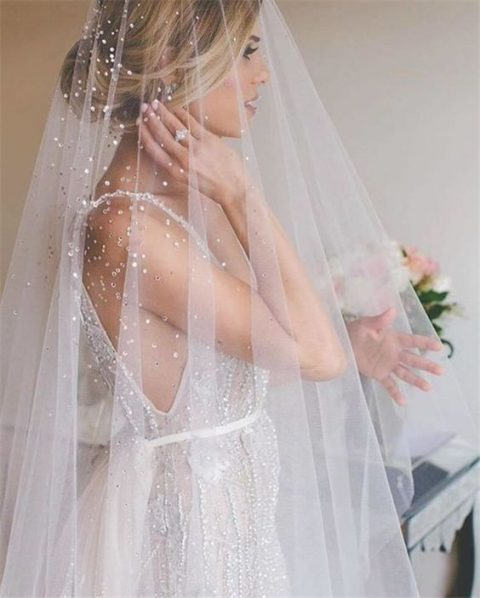 beaded sparkly wedding veil is a gorgeous idea for a winter bride