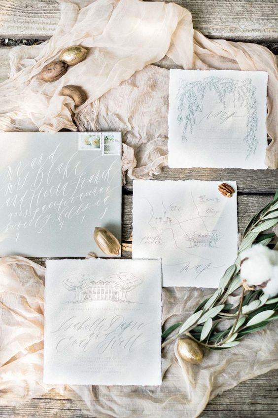 pastel blue watercolor wedding invites with calligraphy, botanical prints and a raw edge