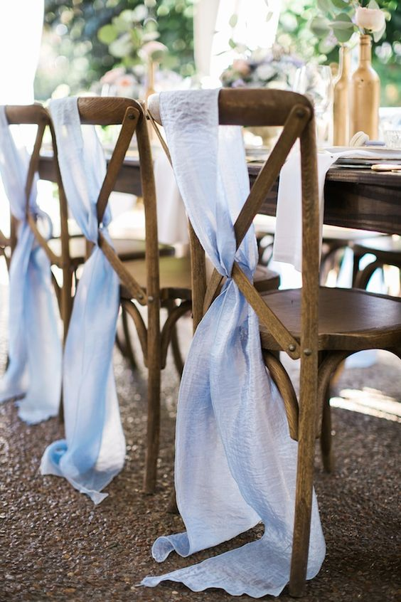wooden chairs covered with ombre blue airy fabric to make them look airy and breezy