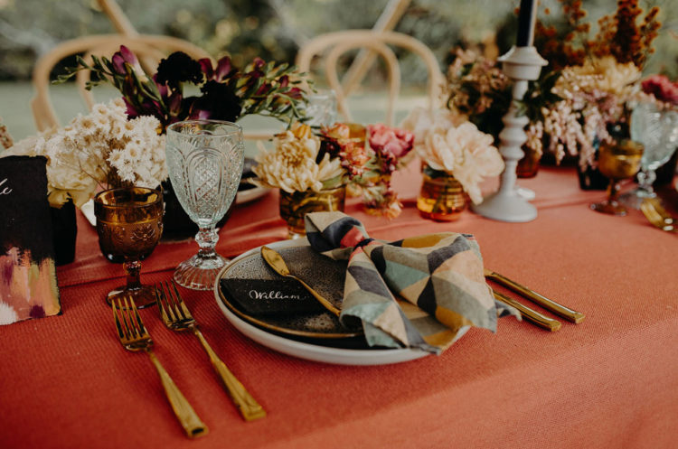 Beautiful geometric print napkins and amber glasses made the tablescape more boho