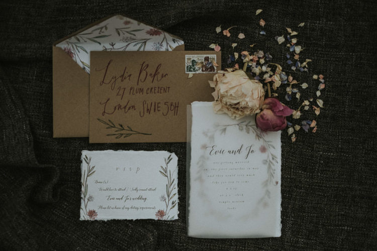 The wedding stationery was with kraft paper envelopes with floral lining and floral and acrylic invites with a raw edge